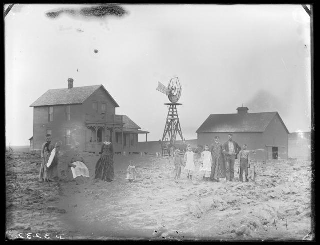 Family in front of the Caywood house at Broken Bow, Nebraska.