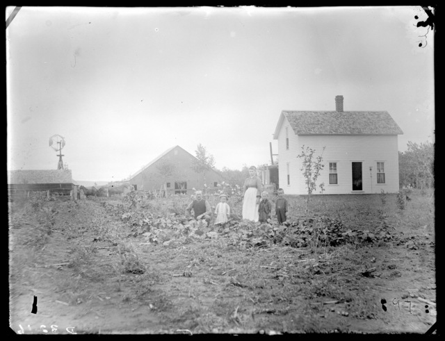 Family near garden at farm house of John Gilliard, southeast Custer County, Nebraska.