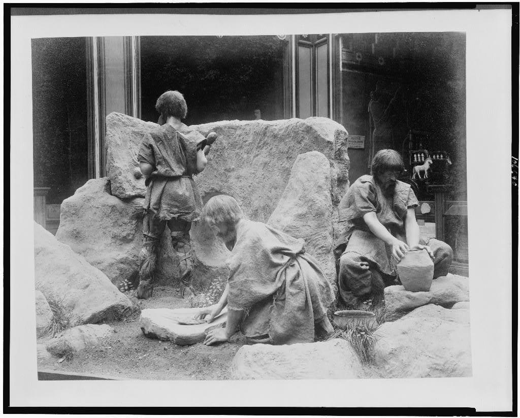 [History of Work exhibit showing diorama of people from the Polished Stone Age building a dolman, polishing a hatchet, and making pottery, Paris Exposition, 1889]