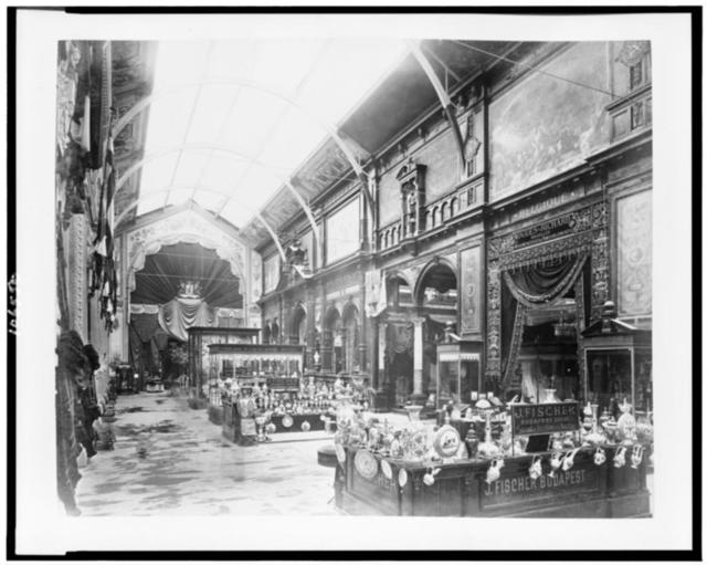 [Interior of the Palace of Diverse Industries showing an exhibit of porcelain and majolica by J. Fischer, Budapest, Hungary, Paris Exposition, 1889]