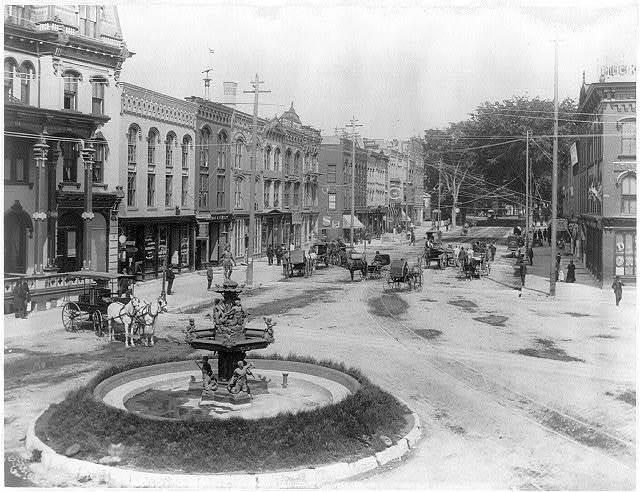 [N.Y. Glens Falls. View across town square and fountain]