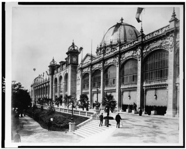 [Palace of Fine Arts, as seen from the side, with a hot air balloon in the distance, Paris Exposition, 1889]