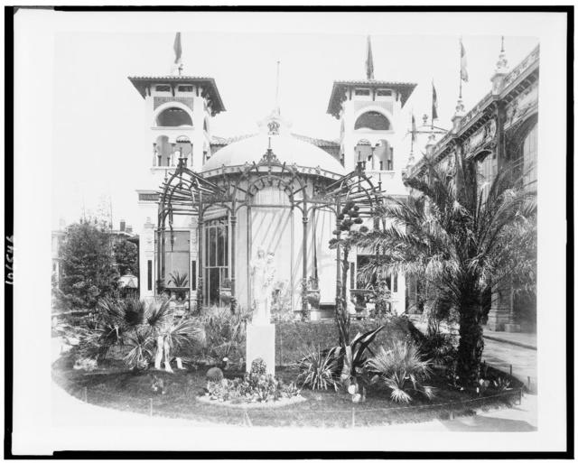 [Rear view of the Pavilion of Monaco, with view of garden and statue of the Virgin Mary, Paris Exposition, 1889]
