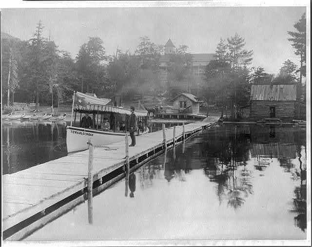 [Small steamboat TOWAHLOONDAH by pier on lake in the Adirondack Mtns., N.Y.]