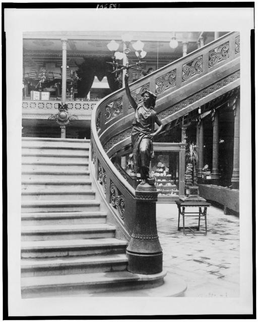 [Stairway with statue of woman holding light fixture (lampadaire) in the Pavilion of Mexico, Paris Exposition, 1889]