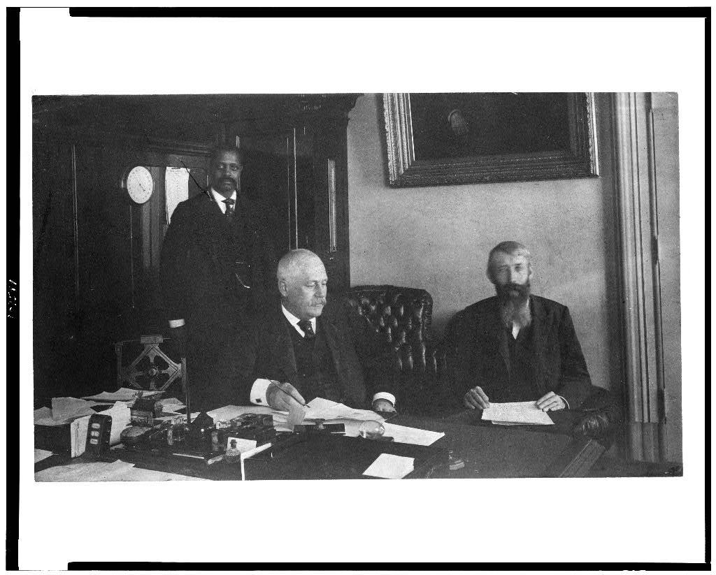 [Three men in office in Bureau of Engraving and Printing, Washington, D.C.]
