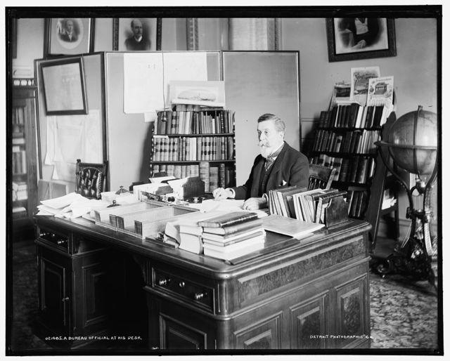 A Bureau official at his desk