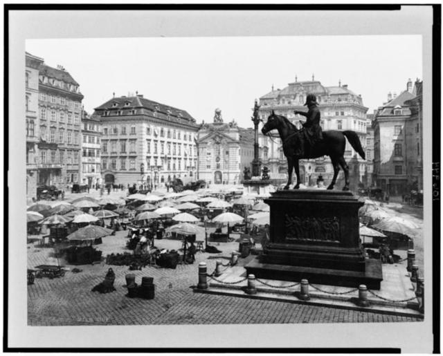 [Am Hof, Vienna, Austria, with open air market and equestrian statue in foreground]