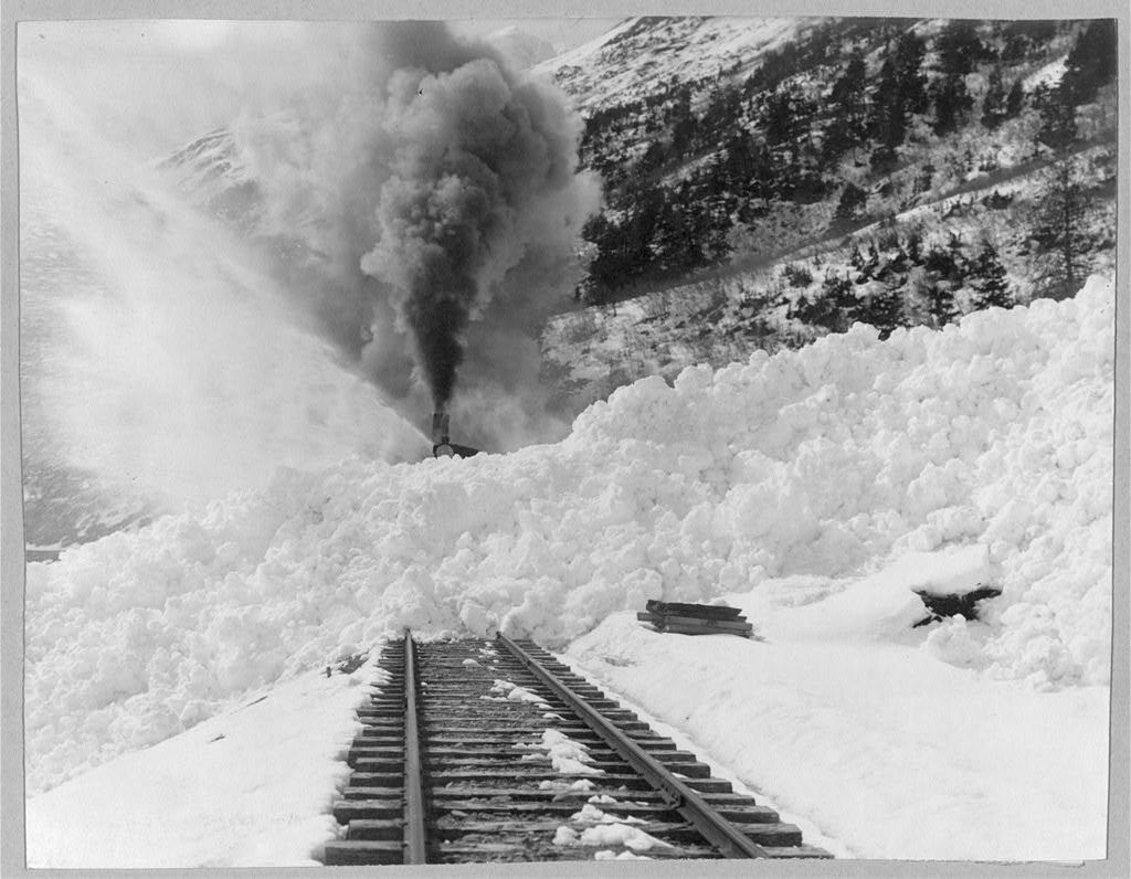 Avalanche of snow across railroad tracks