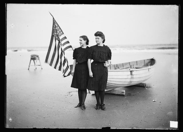 [Bathing beauties by boat with flag, Atlantic City, N.J.]