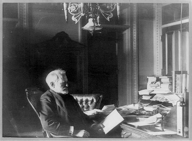 [Benjamin Franklin Tracy, Secretary of the Navy, half-length portrait, seated at desk, facing left, looking at paper] / Miss Johnston, no. 1332 V Street.
