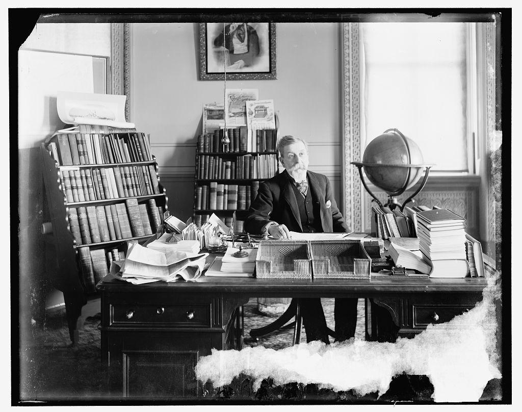 [Bureau official at his desk, A]