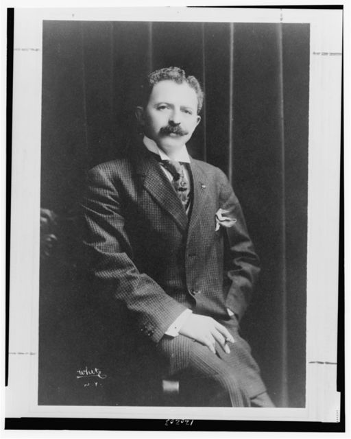 [Charles Kassell Harris, three-quarter length portrait, seated on arm of chair, facing front] / White, N.Y.
