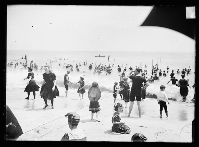 [Children playing with rope at beach, possibly Atlantic City, N.J.]