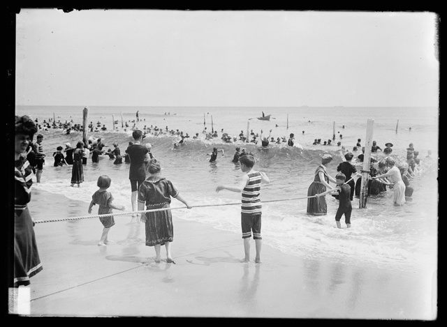 [Children playing with rope, beach, possibly Atlantic City, N.J.]