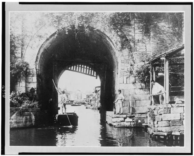 "China, Kiangsu Province, Soochow, water gate in city, which is called ""The Venice of the Far East"" because of its many canals"