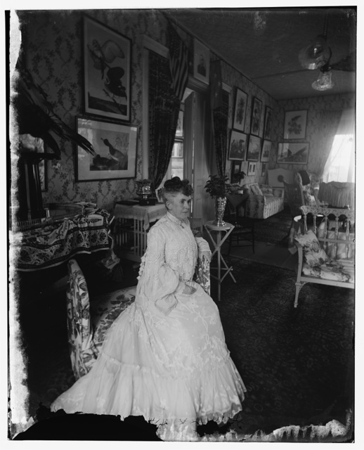 Dewey, Mrs. Wife of Adm. seated in home presented by public, about 1902
