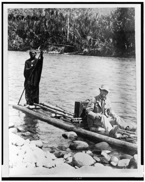 [Explorer, with Indian, on raft, in the Amazon Jungle, South America]