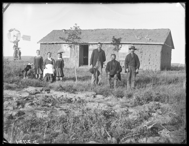 Family in front of a sod house in east Custer County, Nebraska
