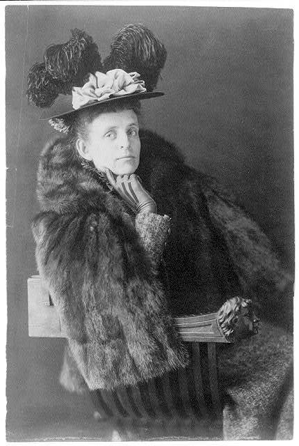 [Frances Benjamin Johnston, 1864-1952, half length, seated, facing right, wearing fur jacket and plumed hat]