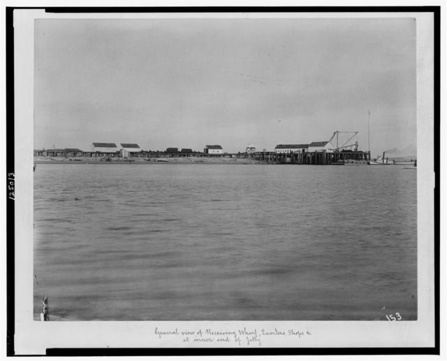 General view of receiving wharf, quarters, shops, etc. at inner end of jetty