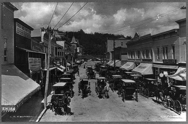 Horse-drawn vehicles on Main Street, Mackinac Island, Michigan
