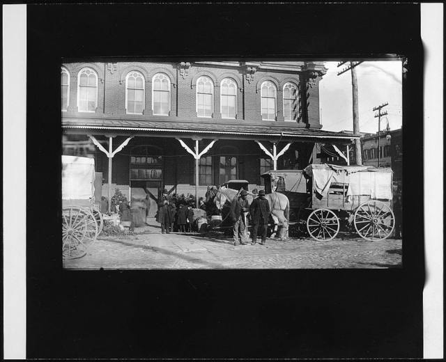 [Horse-drawn wagons in front of the Center Market, Washington, D.C.]