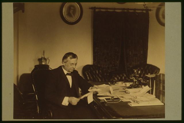 [John Wanamaker, three-quarter length portrait, seated at desk, facing right] / Miss Johnston, No. 1332 V Street, Washington, D.C.