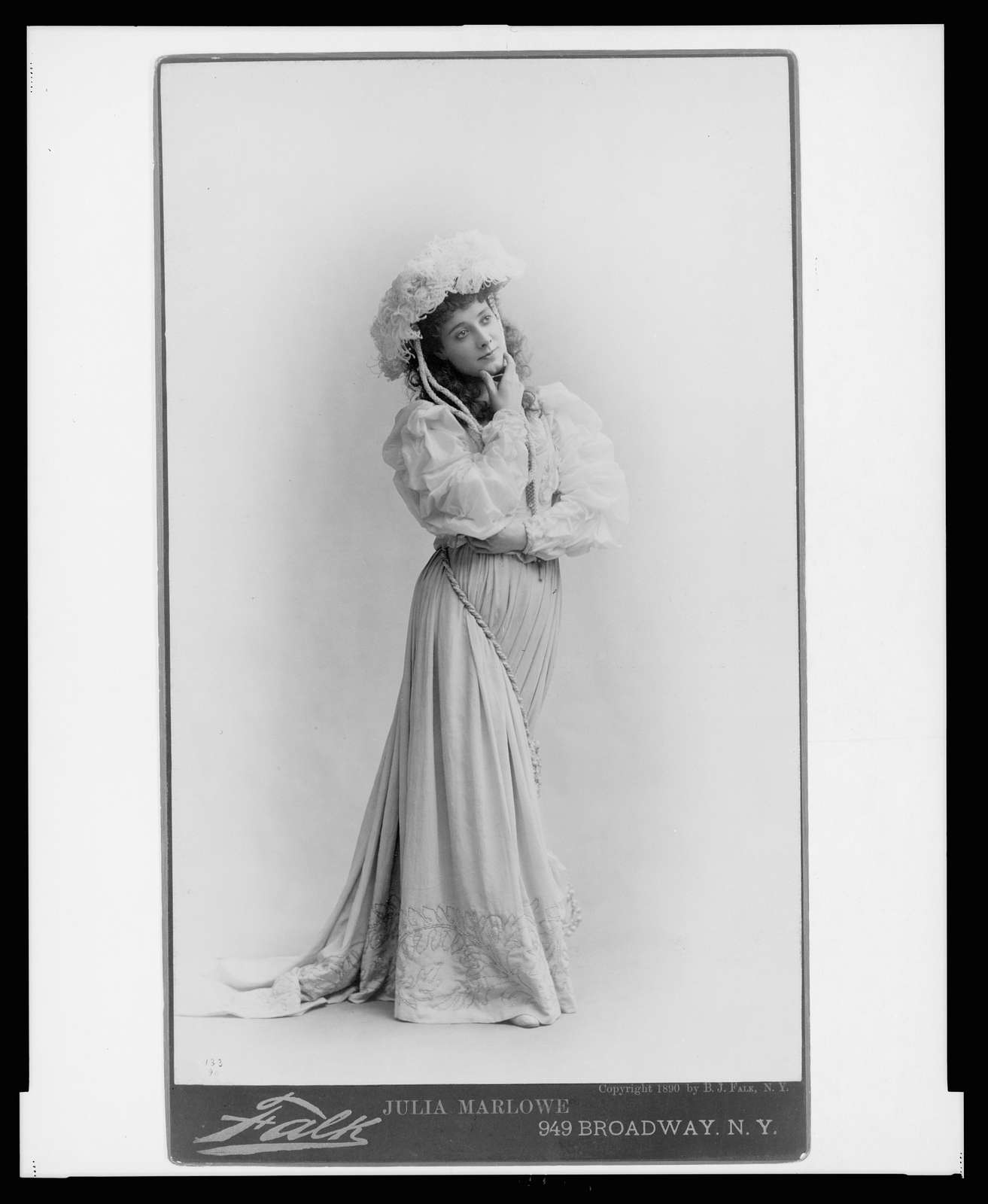 Julia Marlowe, full-length portrait, standing, facing right, with hand on chin Falk, 949 Broadway, N.Y