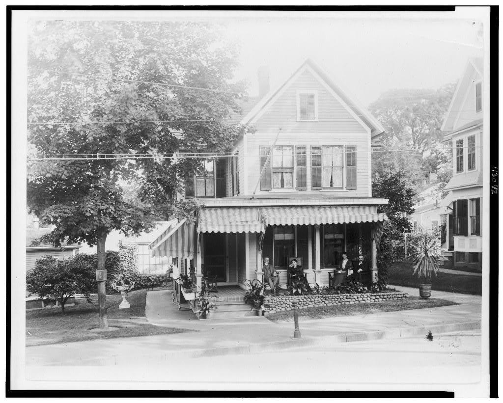 [J.W. Drew, Clara Barton, and Mr. and Mrs. Herman Schloss(?) on porch of house, 26 New St., Ansonia, Conn.]