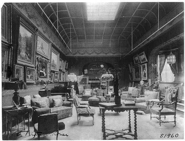 [Large parlor of the William C. Whitney house, Washington, D.C., with many paintings on wall, skylight]