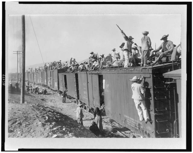 Mexico - Sonora, Yaqui Indians, enlisted in the Mexican Army, being transported by box cars