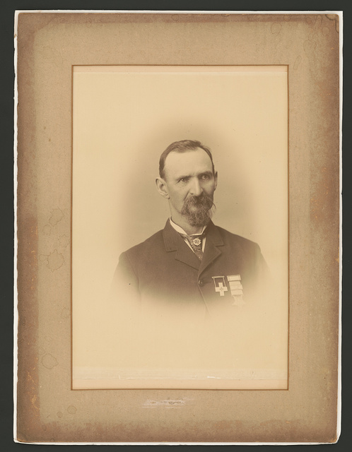 [Nicholas G. Wilson, Civil War veteran, with Grand Army of the Republic medal, Grand Army of the Republic Post #9 pin, and 6th Corps badge]