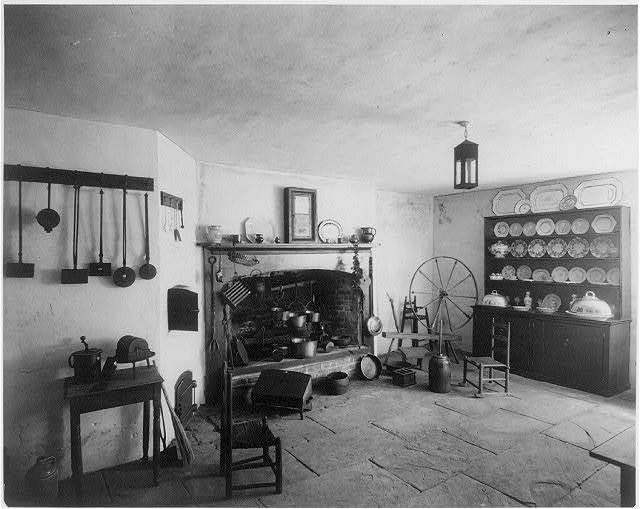 Old kitchen in Telfair Academy, Savannah, Ga. fireplace, china hutch, and spinning wheel.