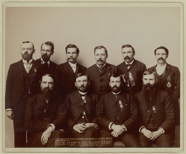 Past Grand Masters of Dakota I.O.O. F., 1890, at Deadwood, S.D.  A.E. Clough, A.E.Nugent, H.J. Rowe, Wm. A. Bently, F.W. Miller, F.S. Emeison. A.G. Smith, R.R. Briggs, Zina Richey, H.J. Rice