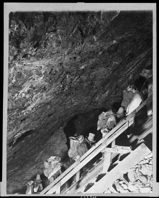 [Peasants carrying two-hundred pound bags of silver ore from mines, Mexico]