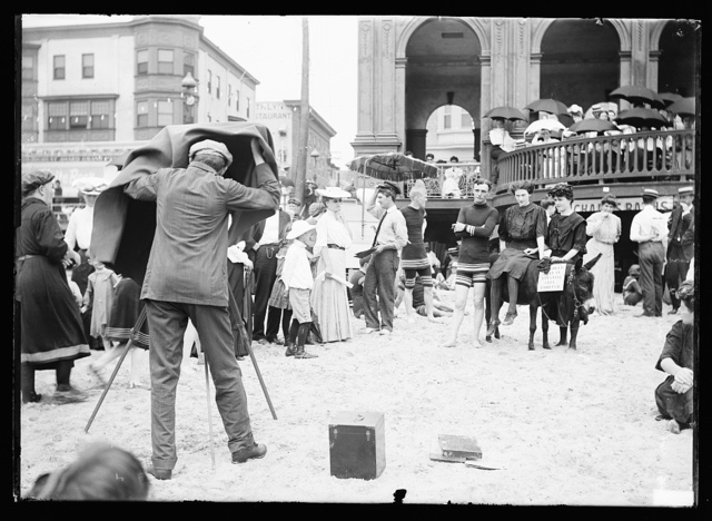 [Photographer taking picture of group with donkey at crowded beach, Atlantic City, N.J.