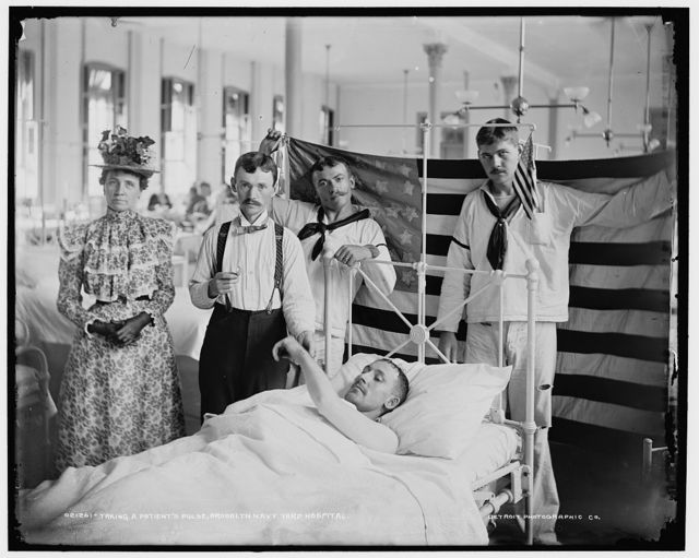 Taking a patient's pulse, Brooklyn Navy Yard Hospital