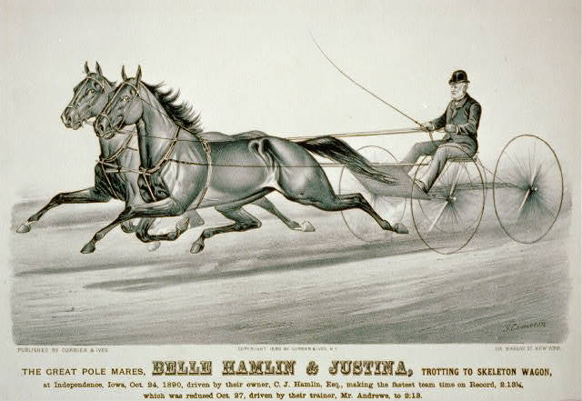 The great pole mares, Belle Hamlin & Justina, trotting to skeleton wagon: at Independence, Iowa, Oct. 24, 1890, driven by their owner, C.J. Hamlin, esq., making the fastest team time on record, 2.13 1/4, which was reduced Oct. 27, driven by their trainer, Mr. Andrews, to 2:13