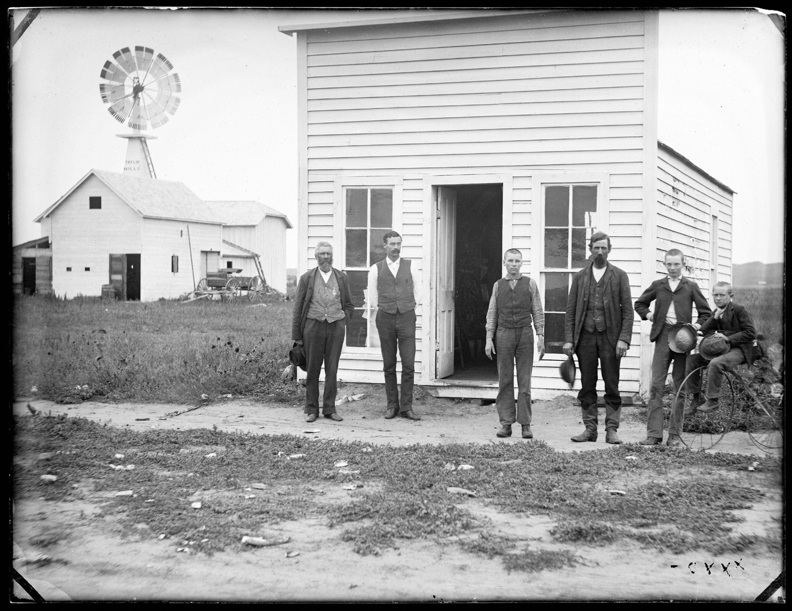 Three men and three young boys in front of the Printing Office, Taylor, Nebraska.