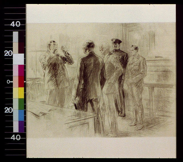 [Two policemen and two men standing listening to fist-waving policeman]
