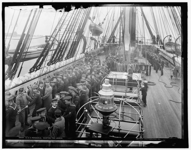 U.S.S. Pensacola, hoisting the launch