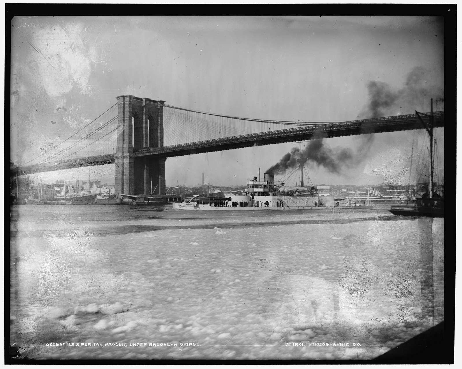 U.S.S. Puritan passing under Brooklyn Bridge