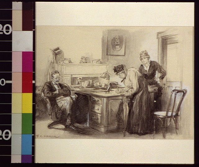 [Woman signing document in office while younger woman and seated man watch]