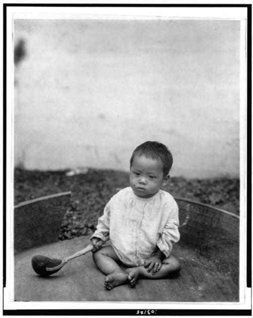 [Asian(?) baby seated holding spoon or ladle, World's Columbian Exposition, Chicago, Illinois]
