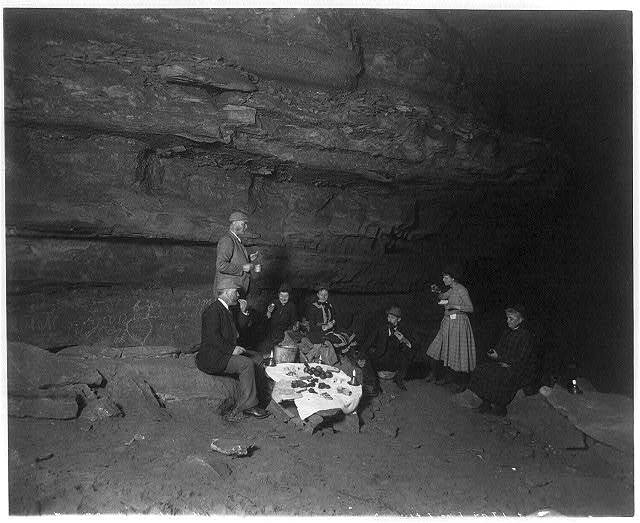 [Frances Benj. Johnston with group of men and women having picnic lunch inside Mammoth Cave, Ky.]