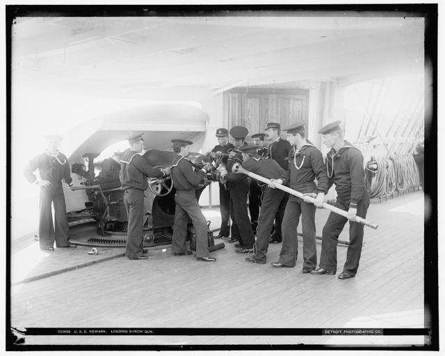 U.S.S. Newark, loading 6-inch gun