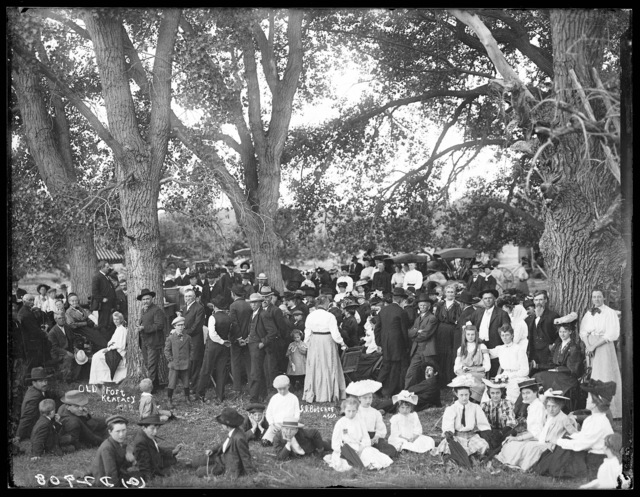 Large group attending a picnic in the cottonwood groves at Old Fort Kearney
