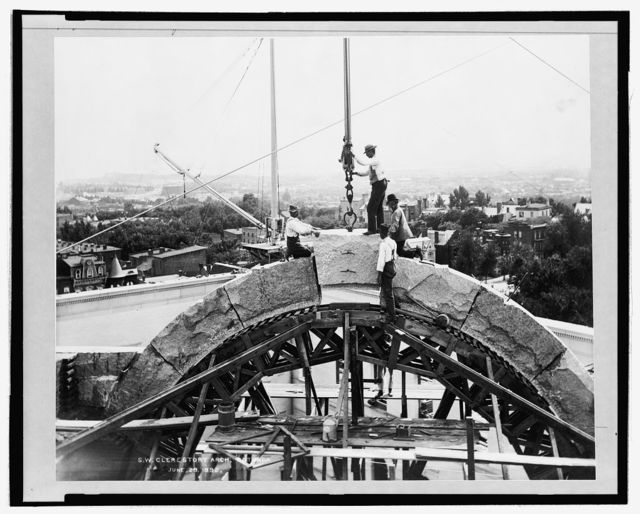 [Men putting in place the keystone of the S.W. clerestory arch of the rotunda of the Library of Congress]