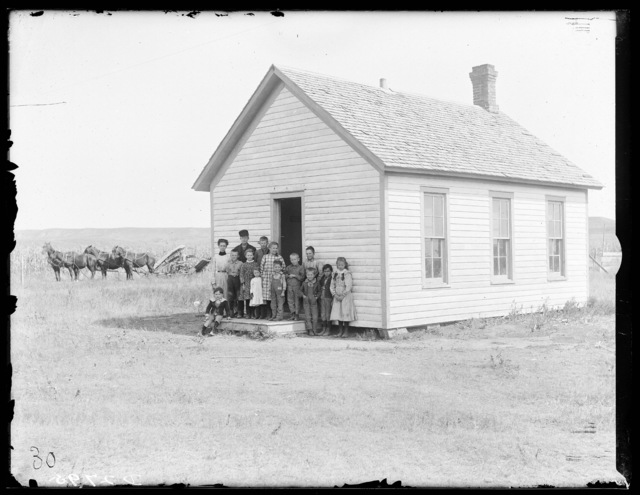 Students and their teacher in front of a country school on the South Loup River east of Callaway, Custer County, Nebraska.